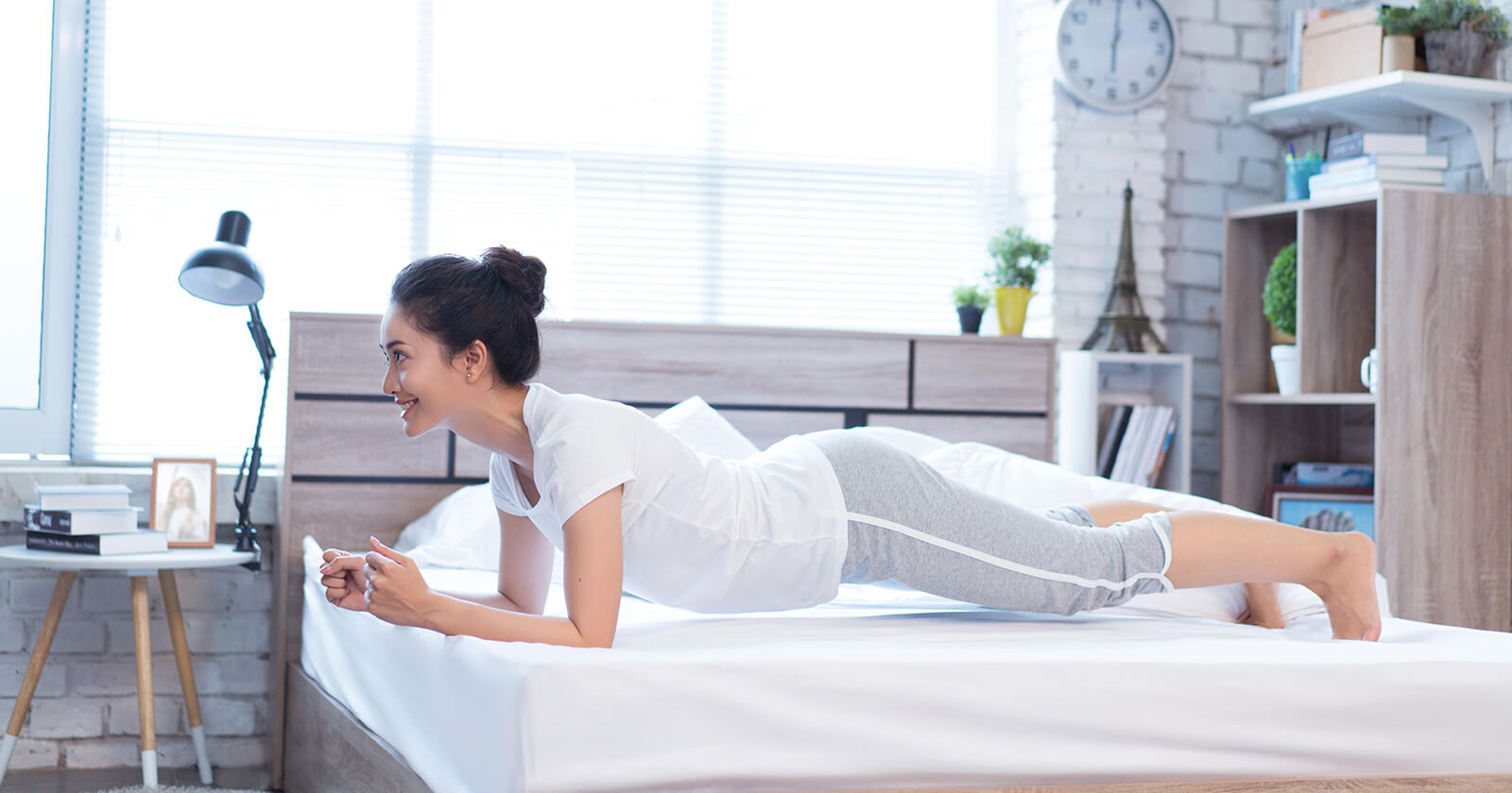 Woman doing Yoga on Mattress